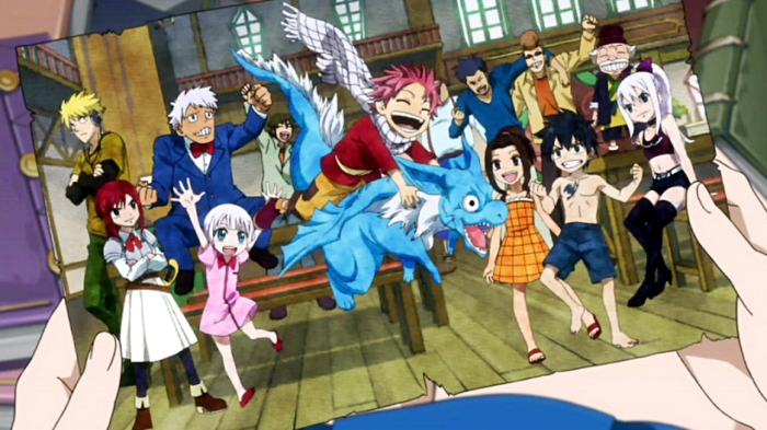 Lucy_holding_a_picture_of_the_young_Fairy_Tail_Mages.jpg